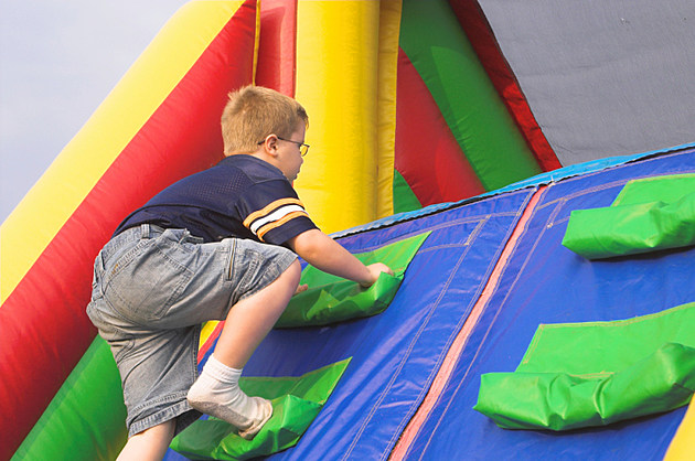 Boy Playing On Obstacle Course