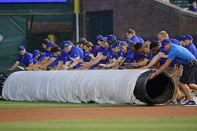 Chicago Cubs Grounds Crew Rolls Out Tarp