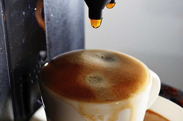 cup of espresso and coffee machine