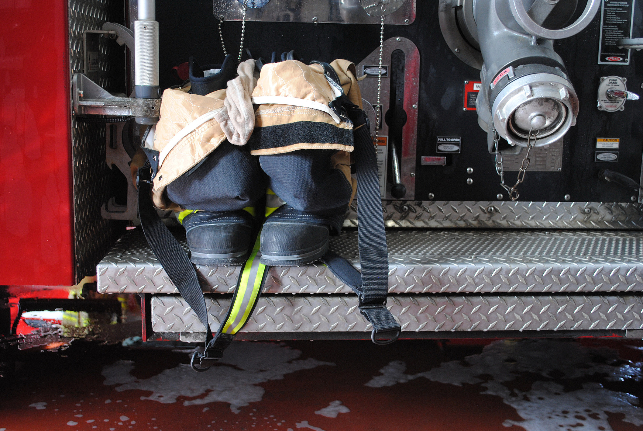 Firefighter Uniform and Boots on Firetruck